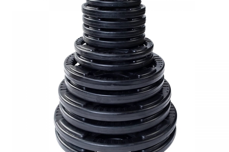 All of the plates stacked on top of each other for the XM Omega Rack Combo