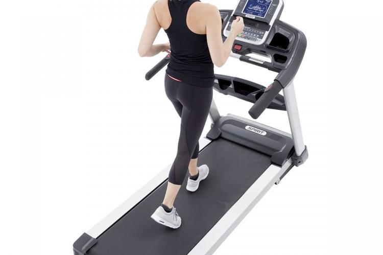 Spark XT685 Treadmill with women runner
