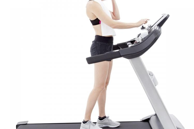 Spark XT685 Treadmill with women