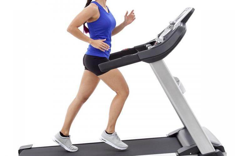 Spark XT685 Treadmill with women runner running incline